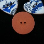 Blue Willow buttons, back of round one, about one inch in diameter ©booksandbuttons