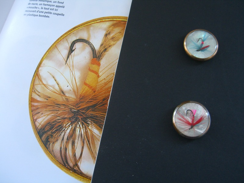 two fish hook buttons on mother of pearl, 22 cms in diameter, ©booksandbuttons