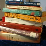 Stack of books to take to a desert island ©booksandbuttons