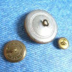 backs of some buttons with white glass©booksandbuttons