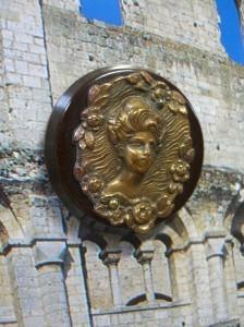 "Bakelite button with brass embellishment of lady's head. 1 3/4"" diameter. ©booksandbuttons"