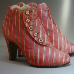 Satin striped booties by Elsa Schiaparelli 1939-40 season.  Scalloped edging, tiny mother-of-pearl buttons to close.