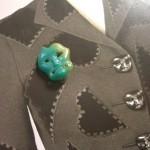my mask button atop Schiaparelli's jacket . . .©booksandbuttons