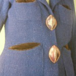 by Schiaparelli 1936-36 season. Two brown leather buttons . . .