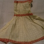 white cotton cover dress with red trims ©booksandbuttons