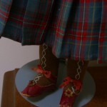 Check out her little red shoes with buckles, and hand embroidered stockings! ©booksandbuttons