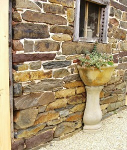 classic interludes--wonderful stone wall and urn with flowers spilling out ©booksandbuttons
