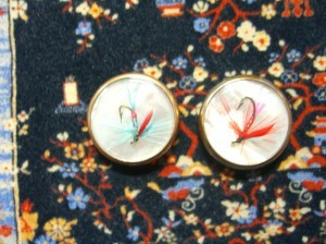 Two mother of pearl buttons with fish hook embellishment ©booksandbuttons