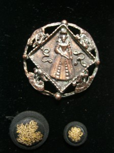 "large button at top is  1 3/8"" in diameter; two early matching buttons with silk embroidered thread design"