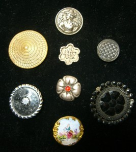 "Eight buttons from Portobello;  brass button with woman's figure is 7/8""  in diameter"