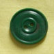 green plastic button©booksandbuttons