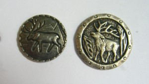 two silver colored moose buttons, less than one inch in diam ©booksandbuttons