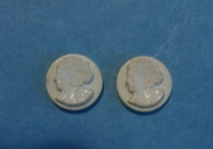 two small plastic buttons from the 1950s ©booksandbuttons