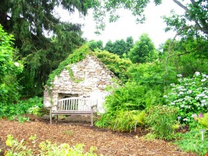 charming stone hut at Burpee Farms and a resting bench