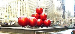 Huge red ornaments at a small plaza in New York