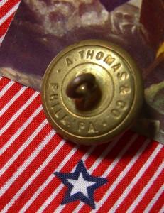 Backmark of military button marked A Thomas & Co Philadelphia PA ©booksandbuttons