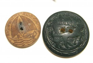 two wooden buttons: sailboat on left; man pullling a large dog in black--myth? ©booksandbuttons